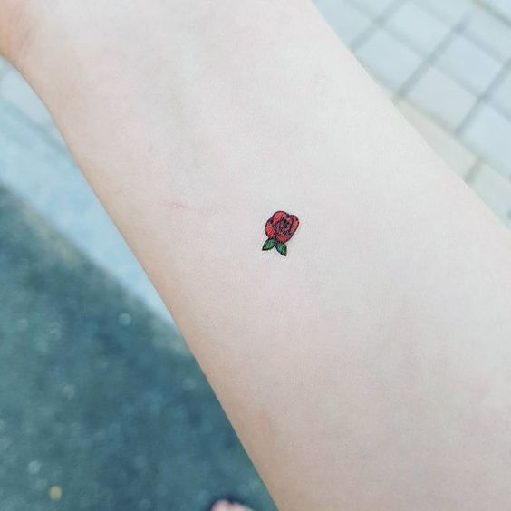 A Tiny red rose tattoo