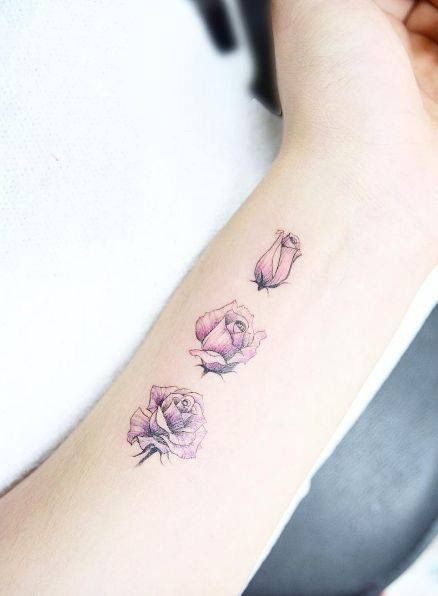 A pink rising rose tattoo