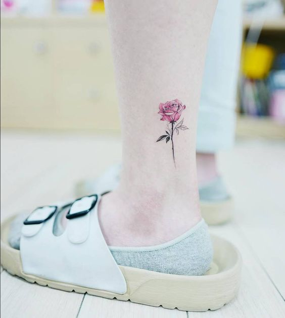 Beautiful small pink rose tattoo on ankle