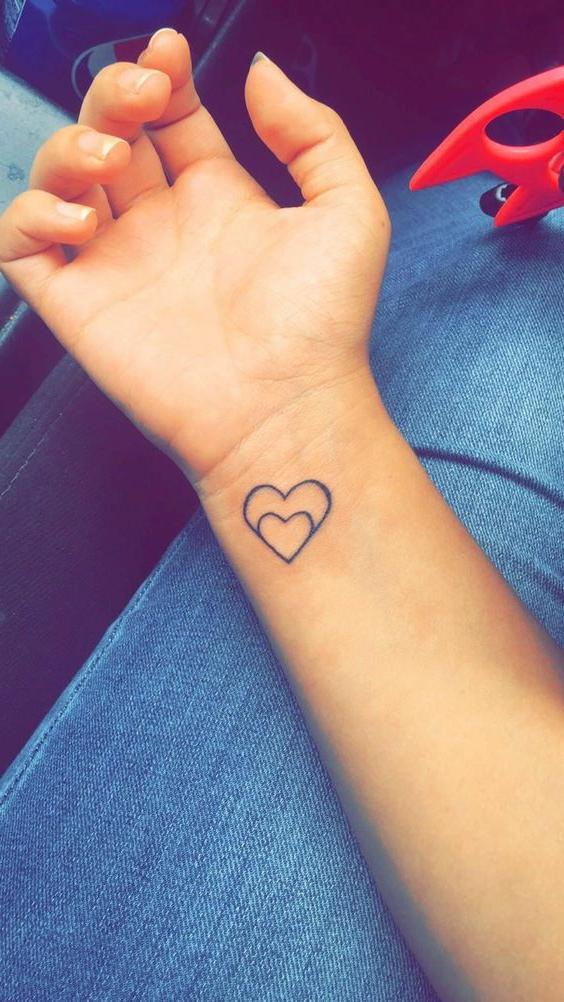 Double Tiny Heart Tattoo On Wrist