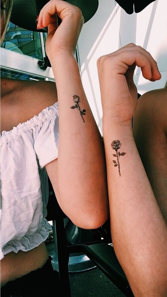 Matching small rose tattoos