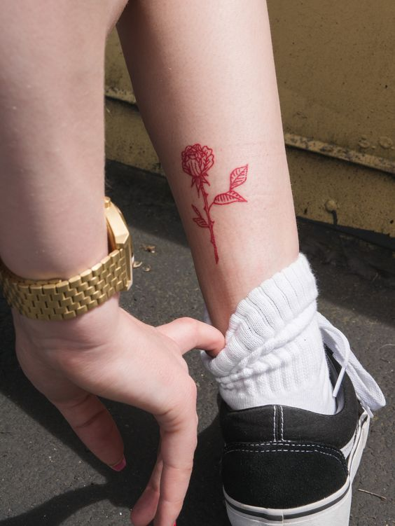 Small red rose tattoo on an ankle