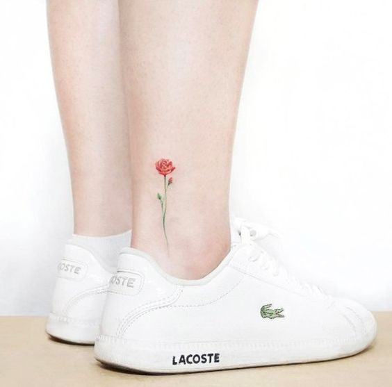 Small red rose tattoo on ankle