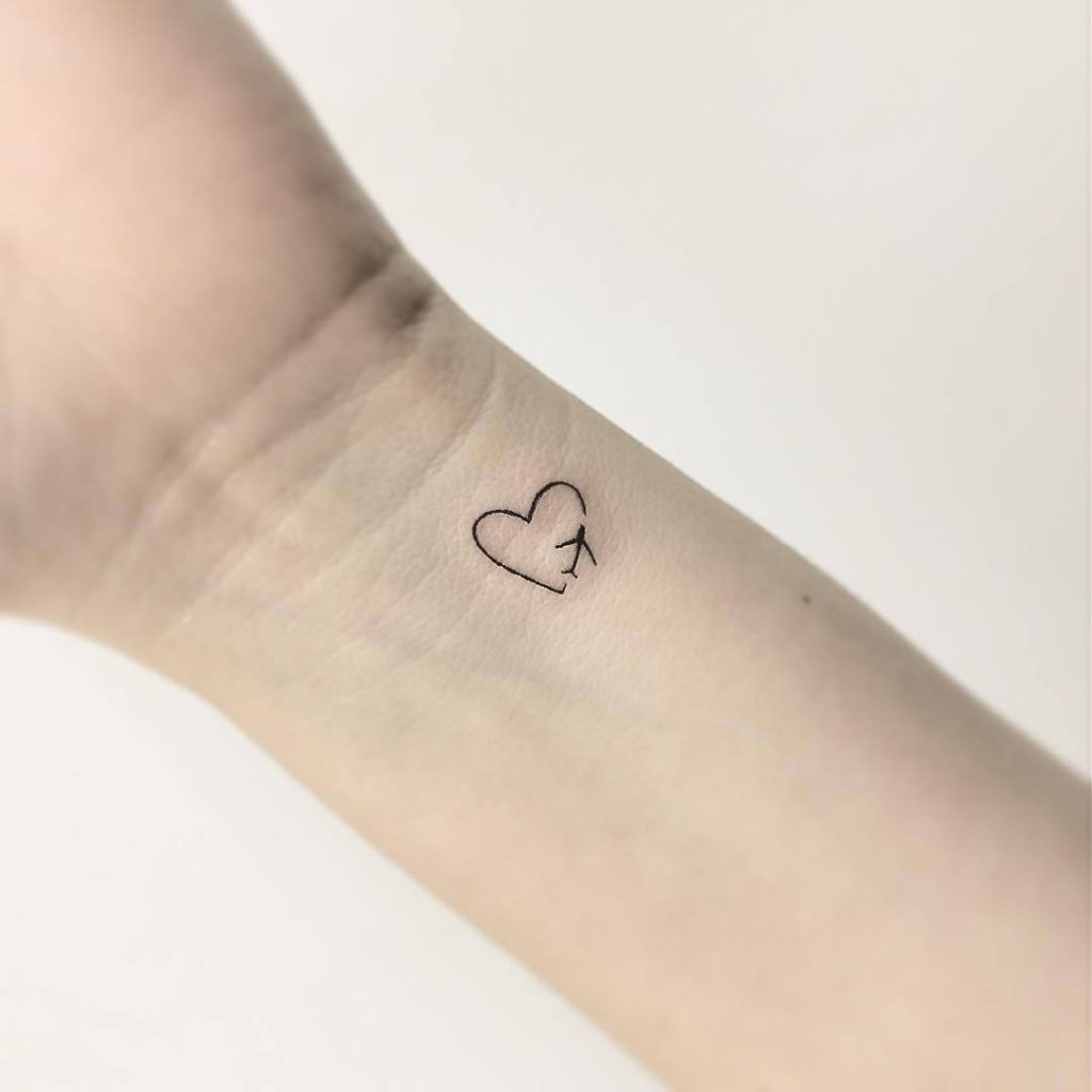 Tiny Heart Tatoo On Wrist