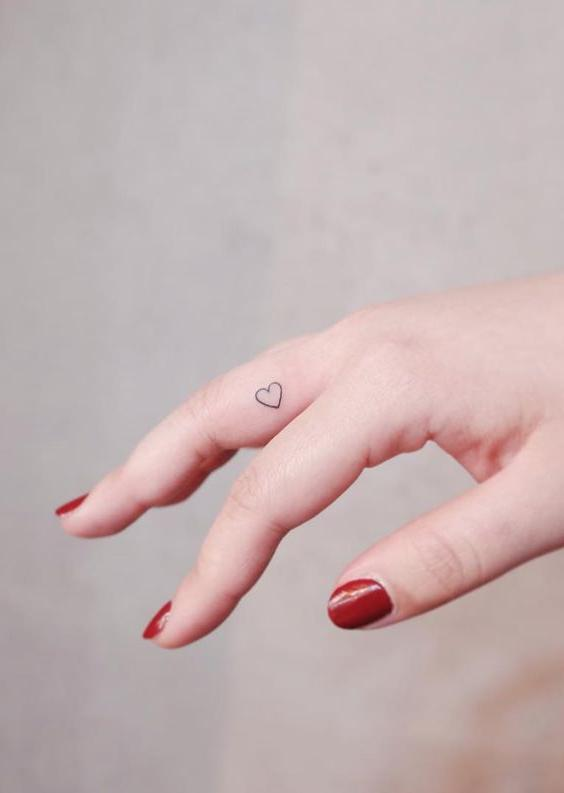 Tiny Linework Heart Tattoo on Finger