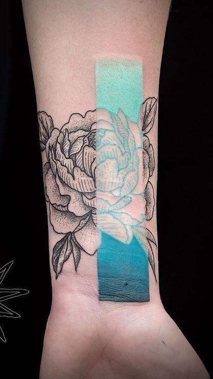 Aesthetic peony tattoo