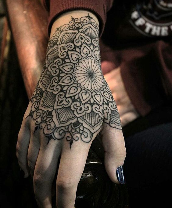 Black mandala tattoo on the hand
