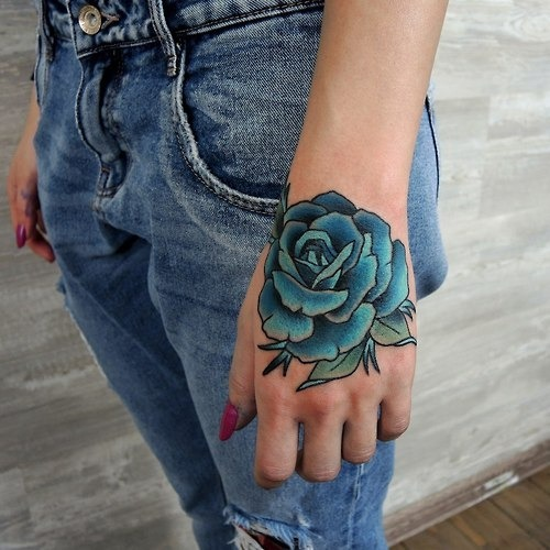 Blue rose tattoo on the hand