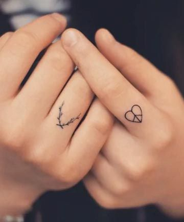 Branches and small heart tattoo on fingers