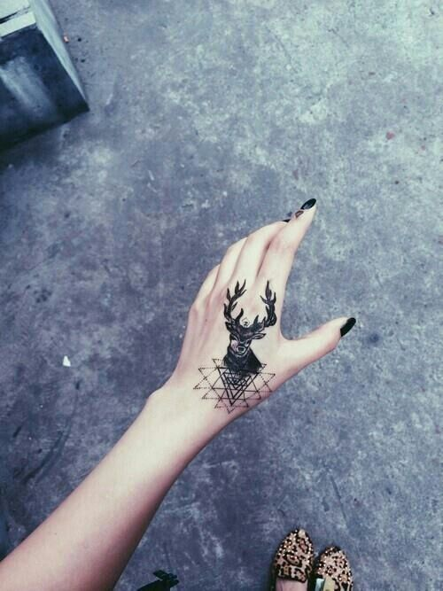 Deer tattoo on the hand