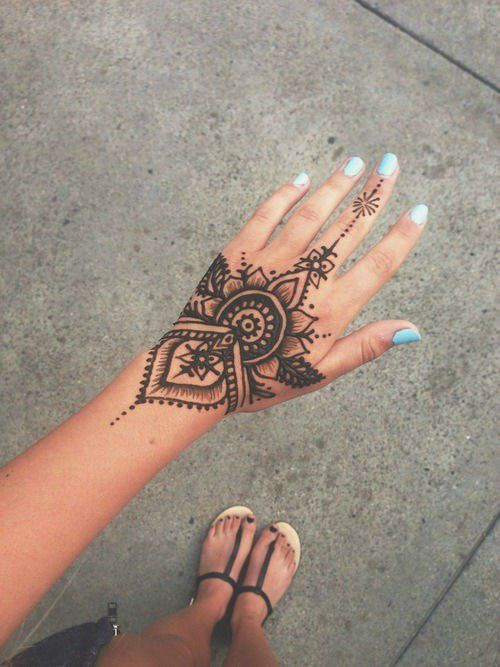 Delicate henna tattoo on the hand