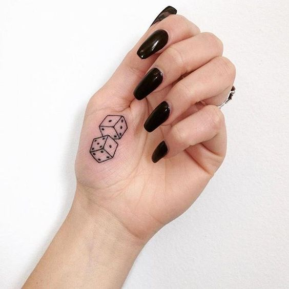 Dice tattoo on the hand