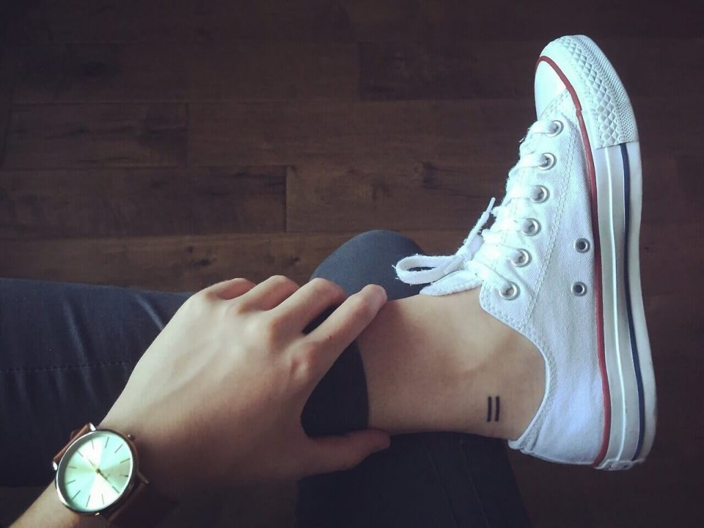 Equal sign tattoo on the ankle