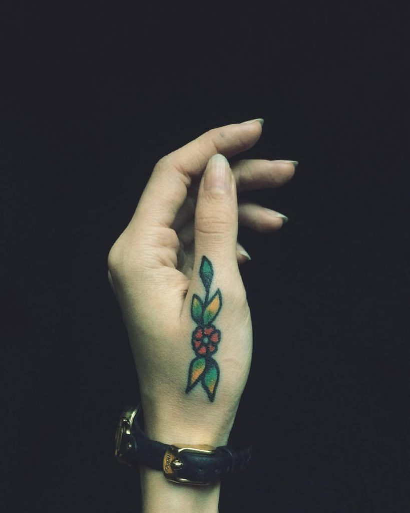 Flower tattoo on a thumb