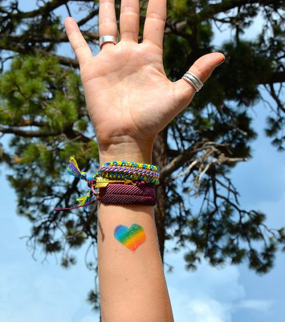 Gay pride rainbow heart tattoo on the wrist