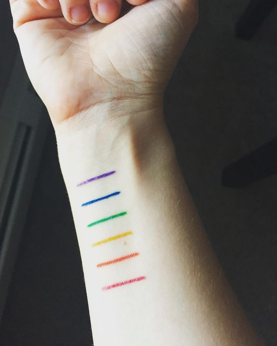 Gay pride rainbow lines tattoo on the wrist