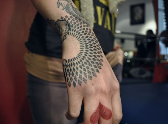 Geometric black tattoo on the hand