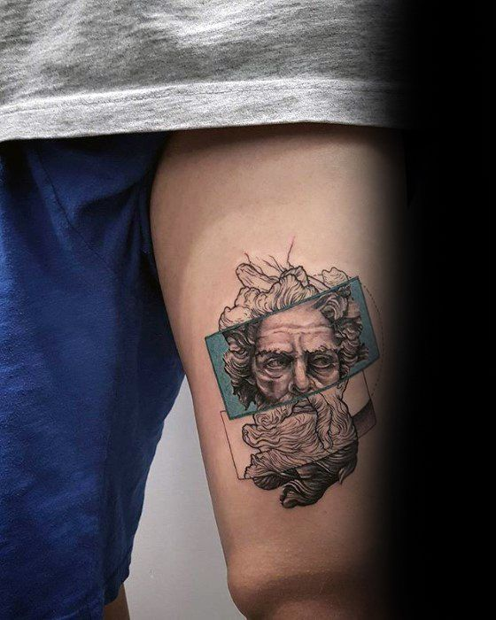 Greek god tattoo on the left thigh
