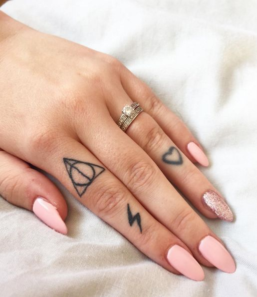 Harry Potter Deathly Hallows tattoo on a finger