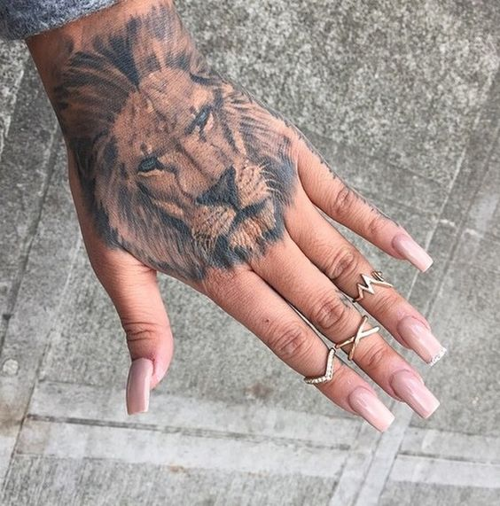 Lion head tattoo on the hand