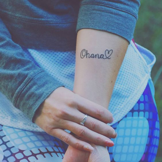 Lovely and subtle ohana with a heart tattoo