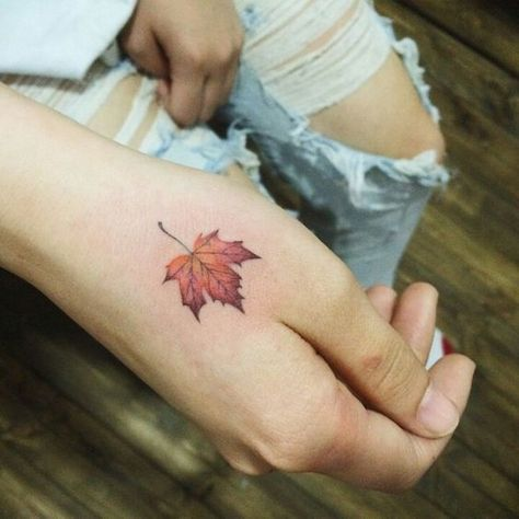 Maple leaf tattoo on the hand