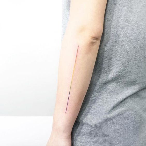 Minimalist gradient line LGBT tattoo on the arm
