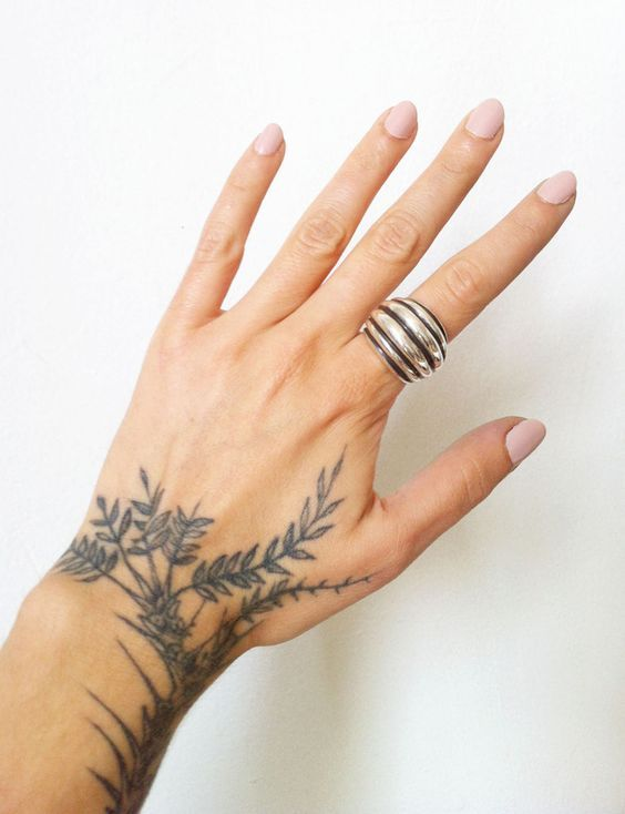 Plants tattoo on the left hand