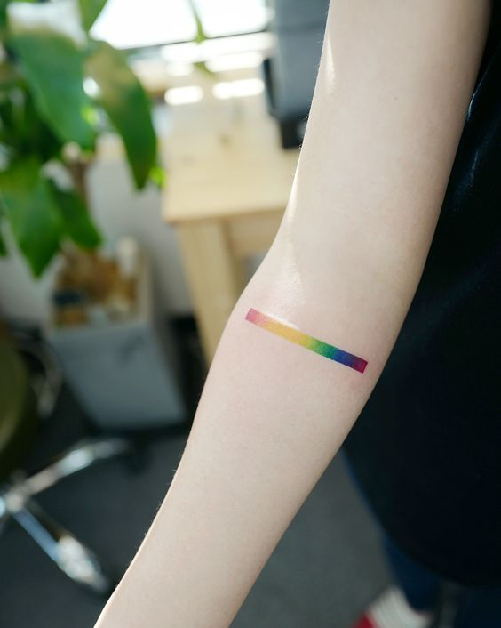 Rainbow spectrum tattoo on arm by tattooist Batul