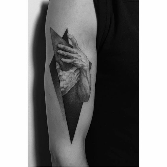 Realistic hands tattoo on the sleeve