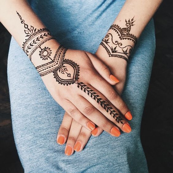 Simple henna tattoo on hands