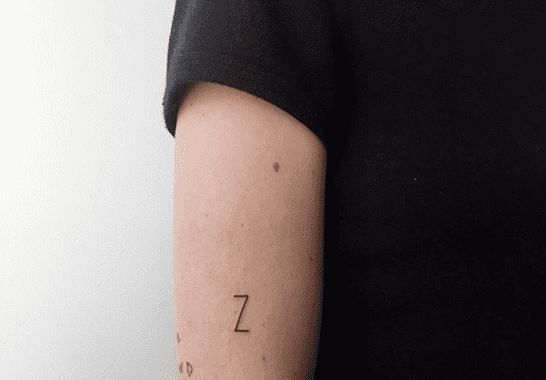 Simple initial Z tattoo on an arm