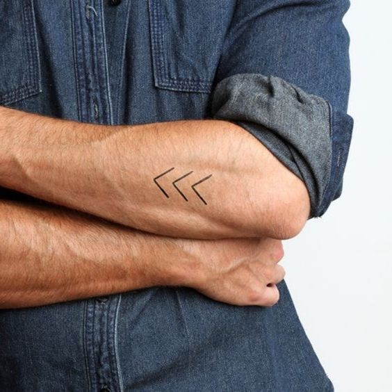 Small Arrow Tattoo On Arm