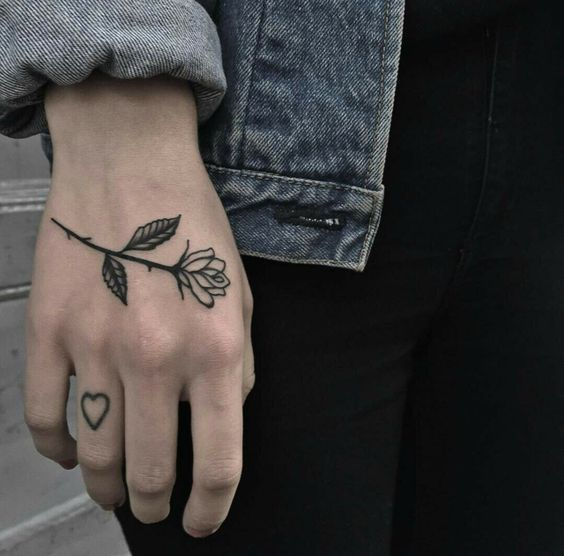 Small black rose tattoo on the hand for women