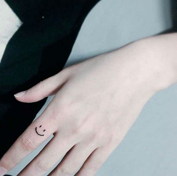 Smile tattoo on a finger