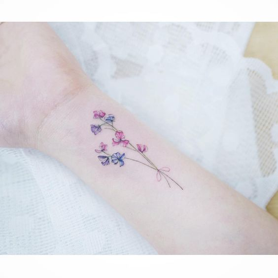 Subtle flowers tattoo by tattooist_banul