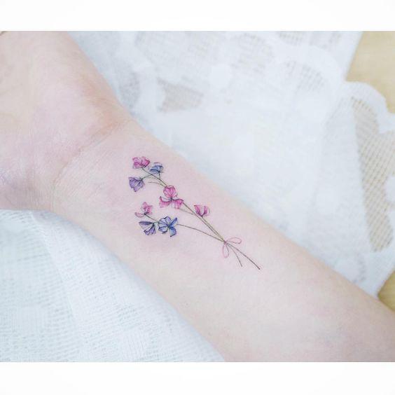 Subtle flowers tattoo by tattooist_banul