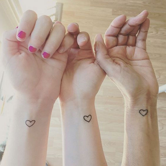 Tattoo idea for sisters - matching tiny hearts on wrists