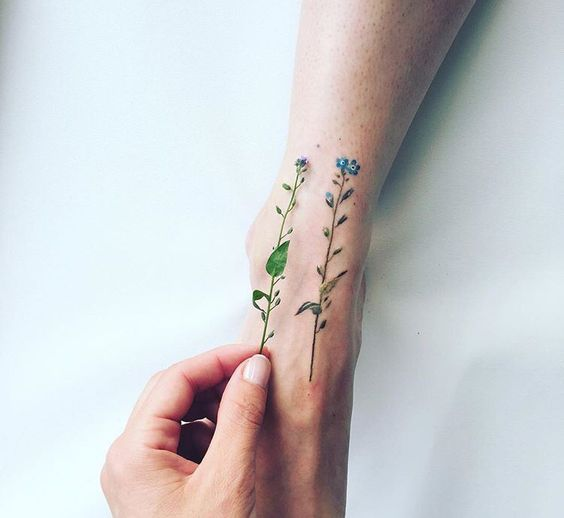 Tiny Blue Flower Tattoo On Feet