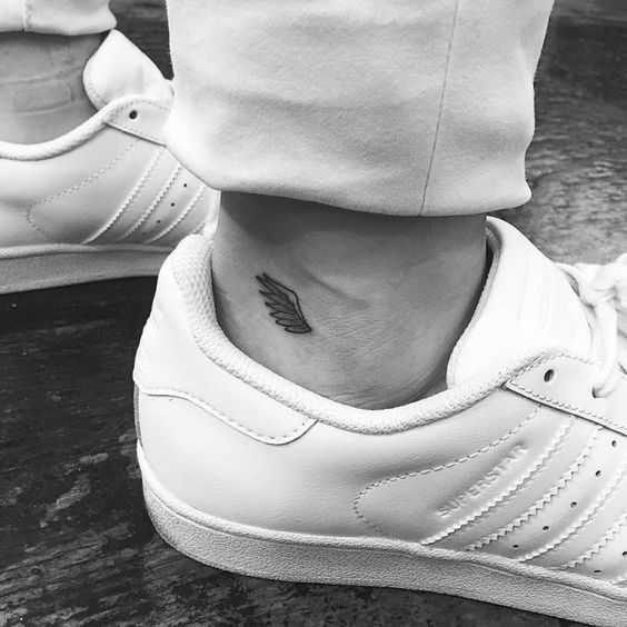 Tiny Wing Tattoo On The Ankle