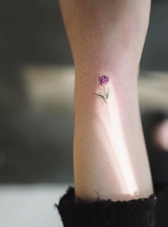 Tiny colourful tulip tattoo on the wrist