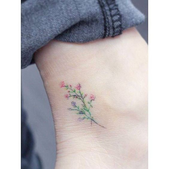 Watercolor flowers tattoo on ankle