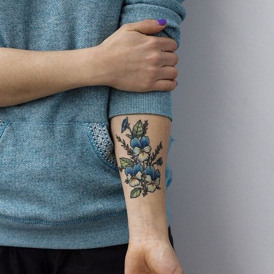 Wildflower tattoo on the inner arm