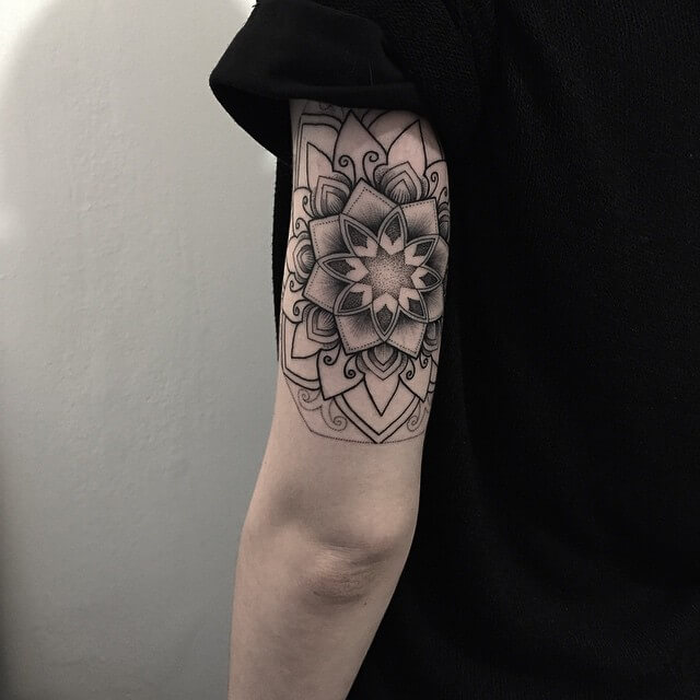 Another excellent mandala tattoo on the upper arm