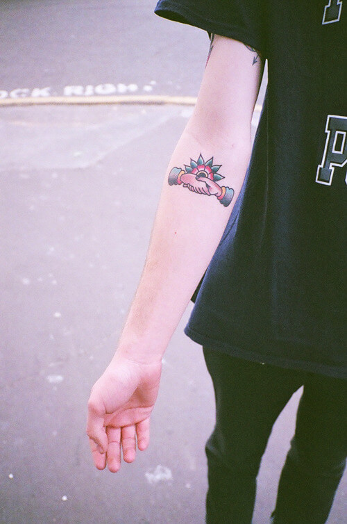 Another small traditional handshake tattoo on the inner arm