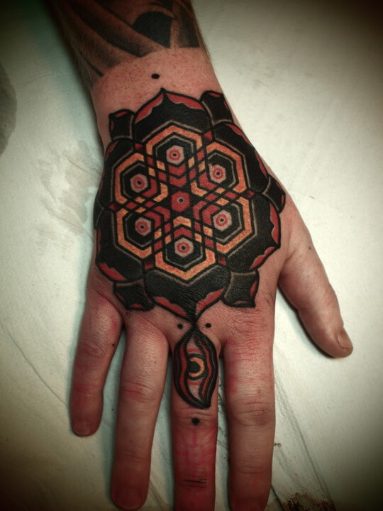 Another traditional coloring mandala tattoo on the hand