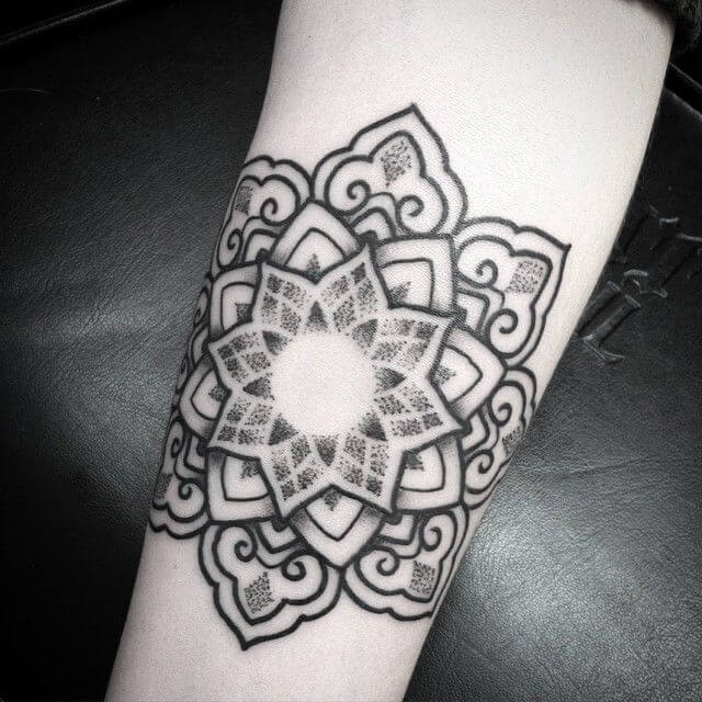 Black and grey dotwork mandala tattoo