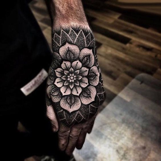 Black flower tattoo on the hand