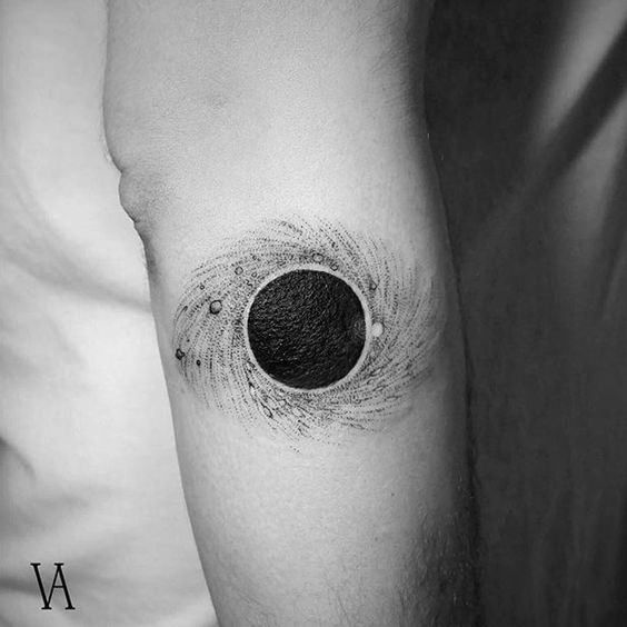 Black hole tattoo on the arm by Violeta Arus