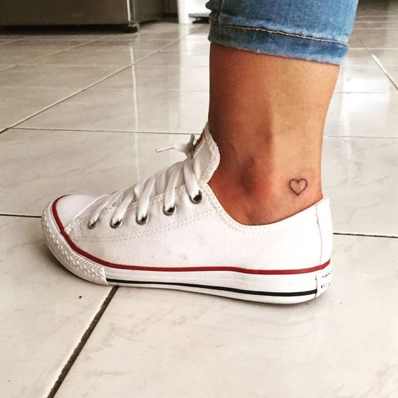 Black outline heart tattoo on the ankle